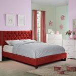Red upholstered tufted bed