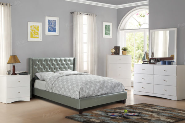 Silver upholstered tufted bed